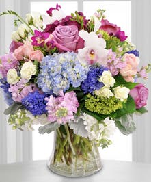 Soft hued floral mix with hydrangea in a vase
