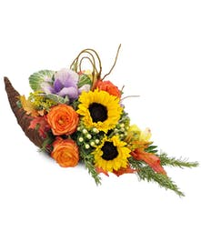 Sunflowers, orange roses kale and berries in cornucopia basket