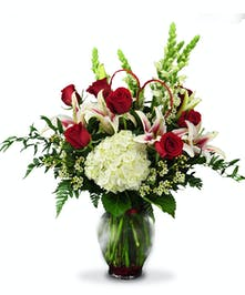 Tall vase of red roses, white Snapdragons, Hydrangea and Stargazers