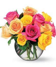 Colorful mix of roses arranged in a compact bubble bowl vase.