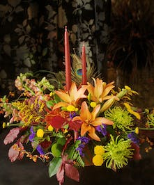 Lilies, peacock feathers, oak leaves, thanksgiving, centerpiece