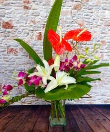 Soft scented lilies, dendrobium orchid and bold, lasting tropical blooms