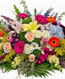 Lilies, roses, Snapdragons, Gerbera Daisies, hydrangea and asters with butterfly casket spray