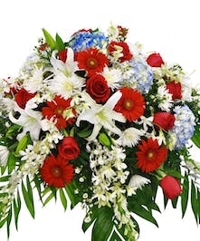 Patriotic colors of hydrangea, roses, Gerbera Daisies and orchids