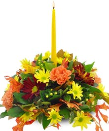 Carnations, mums, fall leaves and taper candle centerpiece