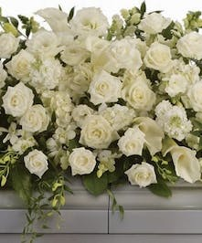 All-white Calla Lilies, orchids, roses and Snapdragons casket spray