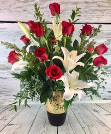 Long-stemmed red roses, lilies and greenery in limited edition keepsake vase