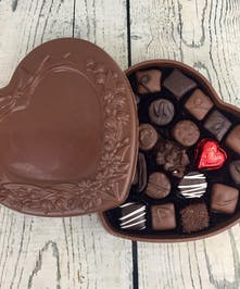 Chocolate heart box filled with truffles