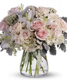 Elegant, roses, lilies and hydrangea gathered in vase