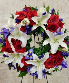 A full floral wreath in red, white and blue