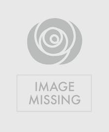 Pink spray roses, glittered leaves, waxflower, and ribbon accents.