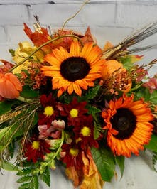 Sunflowers, tulips, mums , snapdragons and fall trim