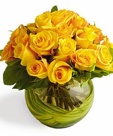 Yellow roses with minimal greenery in bubble bowl vase