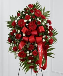 Red roses, Gerbera Daisies, roses, white button mums spray with ribbon banner