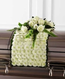Floral blanket of white Chrysanthemums with spray of roses
