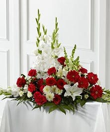 Red roses, carnations, gerbera daisies, gladiolus, snapdragons, lilies and chrysanthemums