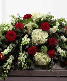 Red roses, white snapdragons & hydrangea casket spray