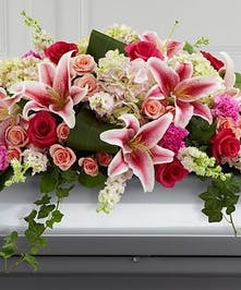 Stargazer Lilies, hydrangea, roses and larkspur in pink, casket cover