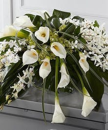 Calla Lilies, Dendrobium orchids, tropical leaves casket spray