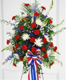 American pride in delphinium, carnations and mums in spray