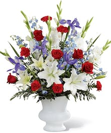 Fan-style flowers featuring lilies, gladiolus, iris and roses in urn