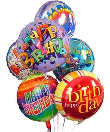 Multiple mylar balloons with colorful birthday messages