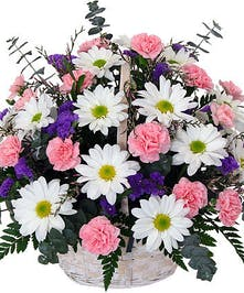Basket of pink carnations and white daisies with statice accent