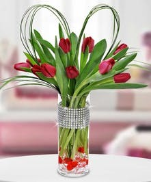 Red tulips with grass heart and bling band on vase