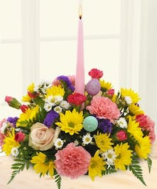 Easter centerpiece filled with colorful daisies and carnations