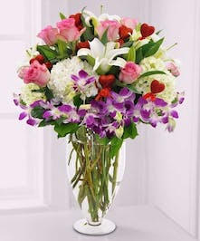 Orchids, lilies, hydrangea and hearts in vase