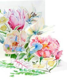 A pastel garden of floral fantasy in a pop-up gift card