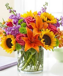 Sunflowers, orange lilies, with lime and purple flowers