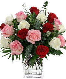 Pink, white, red roses with eucalyptus in glass cube vase