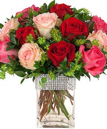 Red and multiple pink roses in vase with rhinestone rim accent