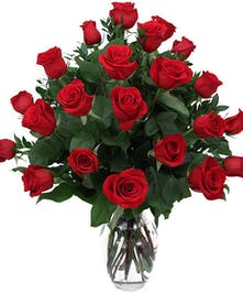 Two dozen red roses with greenery and baby's breath in tall vase