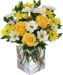 Daisies and yellow roses in compact vase design