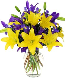 yellow lilies, purple iris, minimal greenery, tall glass vase