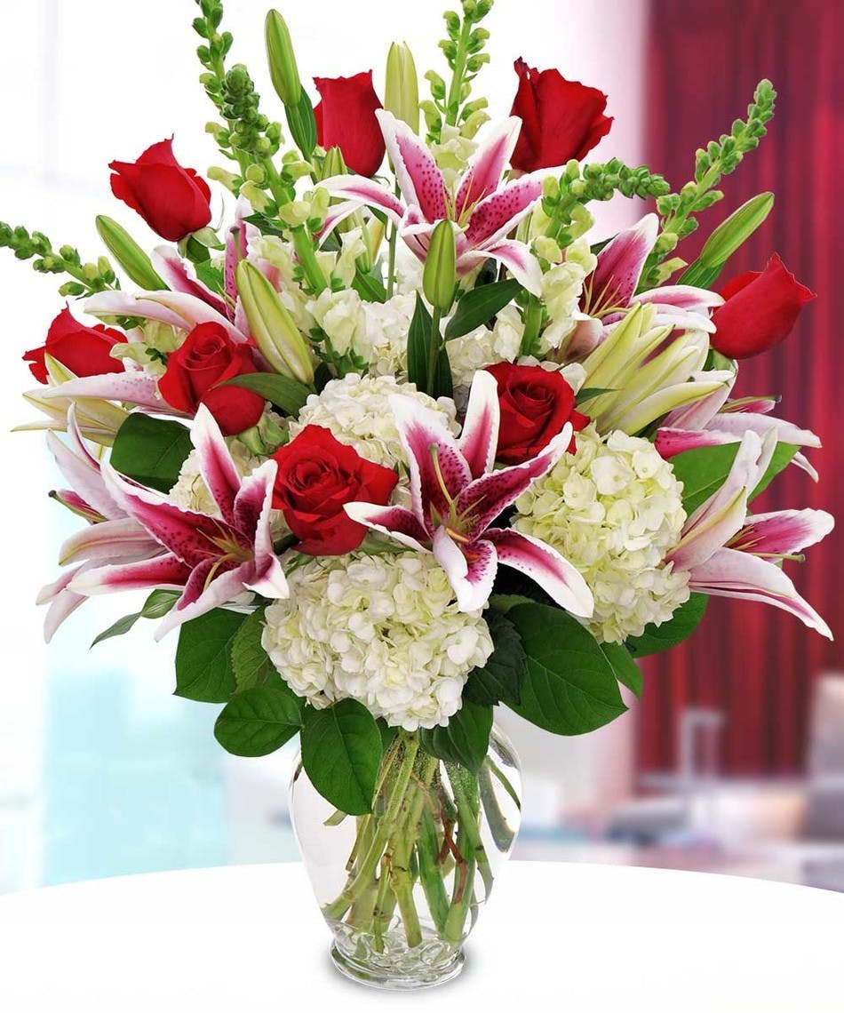 Valentines day luxury flower delivery anchorage florist stargazer lilies red roses white hydrangea in large glass vase izmirmasajfo