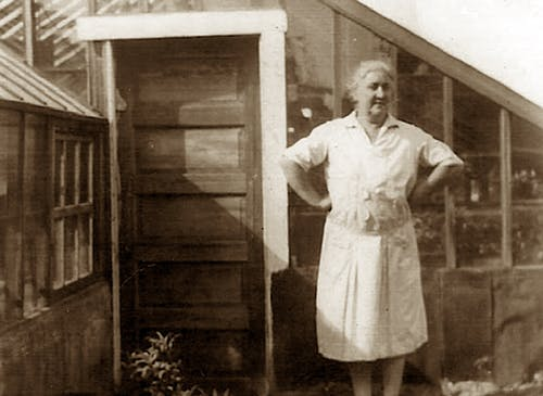 Marie Bagoy supervises an early greenhouse in the mid-1920s